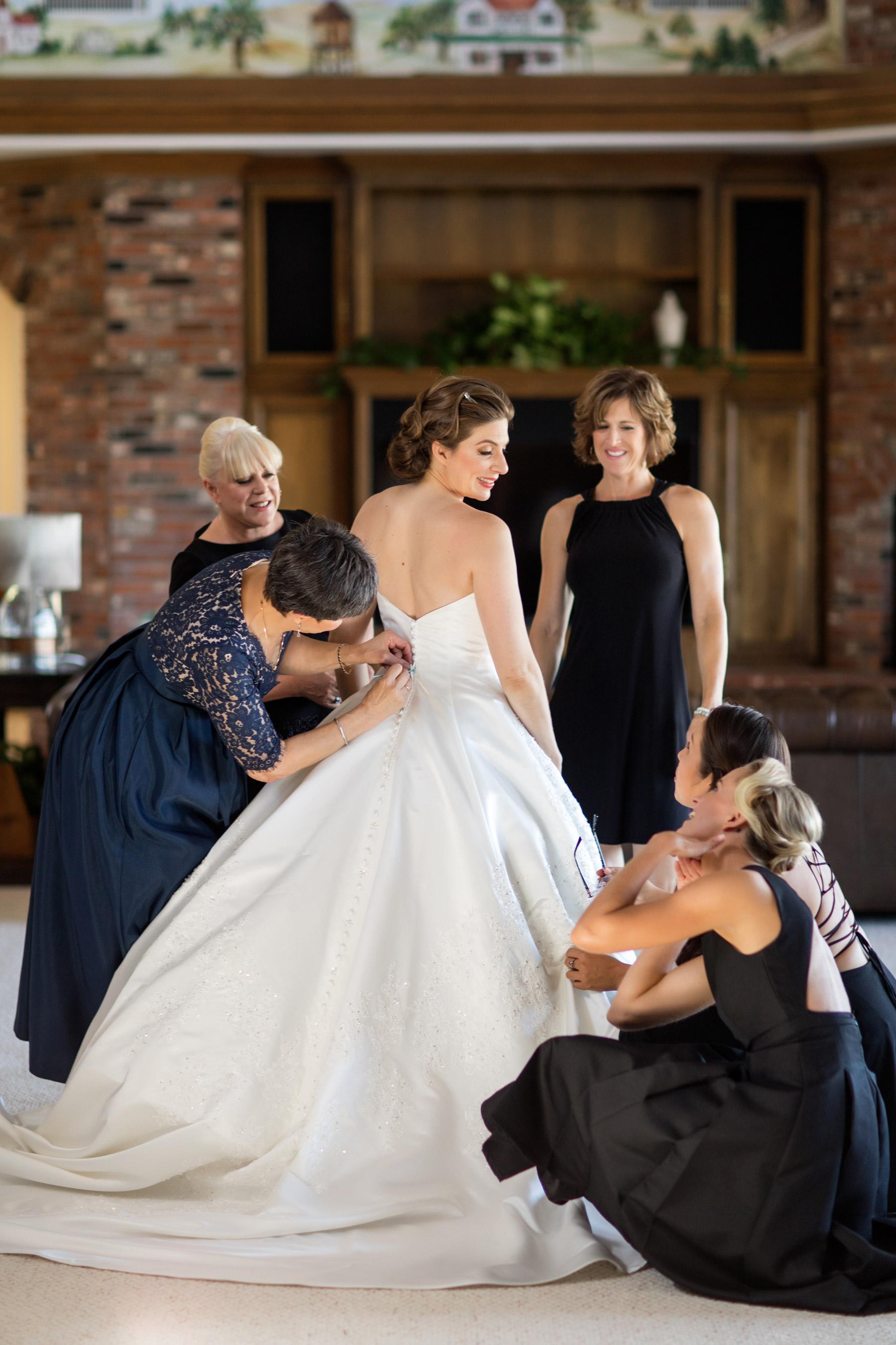 bride getting dresses los olivos
