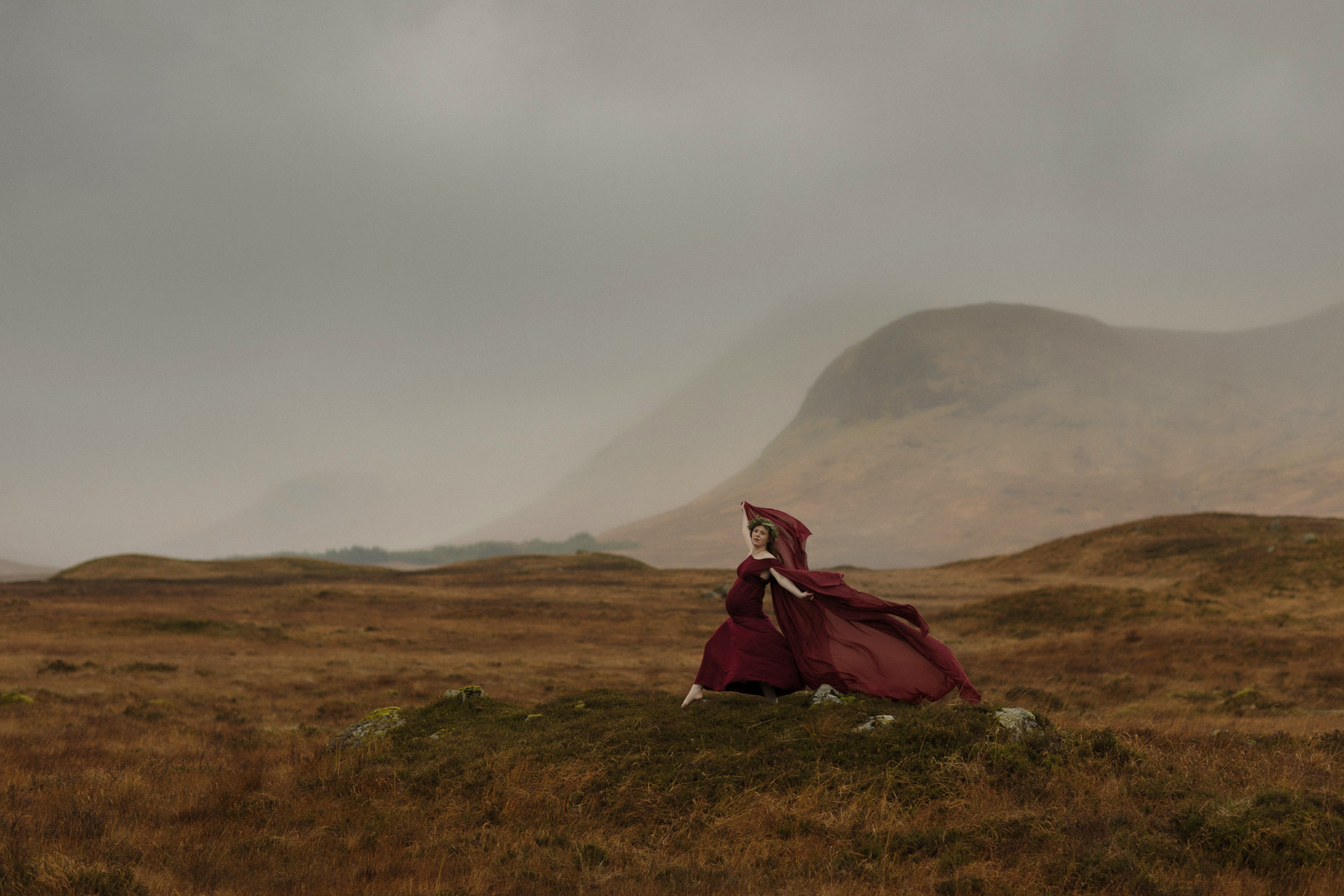 pregnant woman in red dress in glencoe scotland