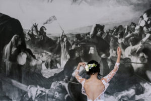 bride-get-ready-in-front-of-huge-wall-painting
