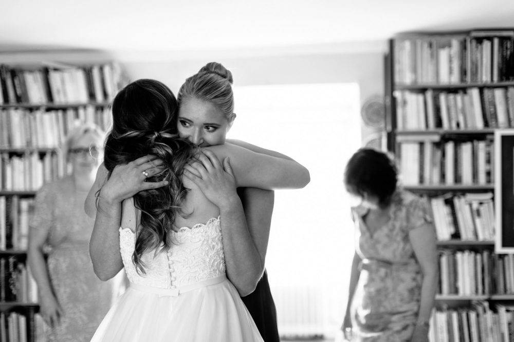 hugs on wedding day in sweden