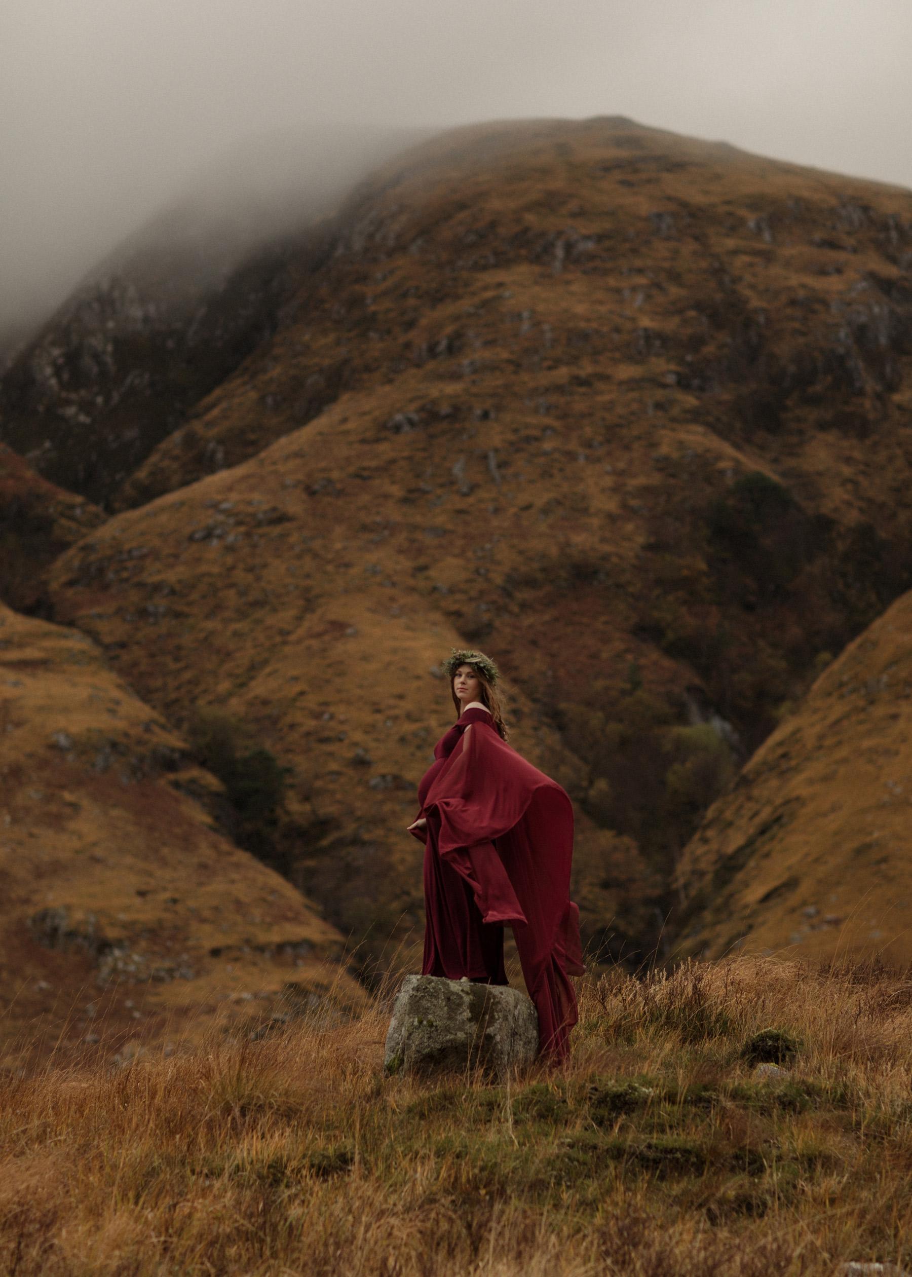 pregnant woman on stone scottish highlands