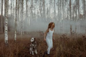 freckled girl and a freckled dog