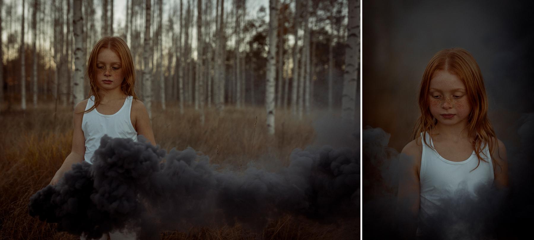 portratt-fraknig flicka med rokbomb
