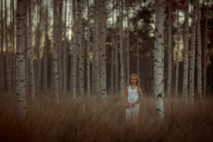 red haired girl in birch forrest